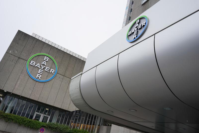 30 March 2020, Berlin: View of the logo of the chemical company Bayer AG on Müllerstraße. Bayer AG plans to support the fight against the coronavirus pandemic with further measures and provides equipment from research departments throughout Germany. At the Berlin-Wedding site alone, more than 140 employees have volunteered to work in a new test laboratory. Photo: Jörg Carstensen/dpa (Photo by Jörg Carstensen/picture alliance via Getty Images)