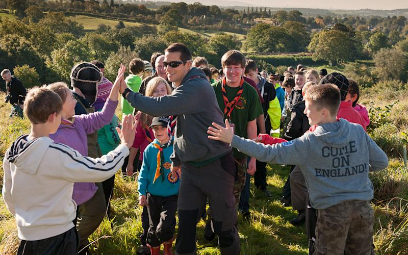 Bear Grylls with some scouts - Credit: Martyn Milner/Scout Association