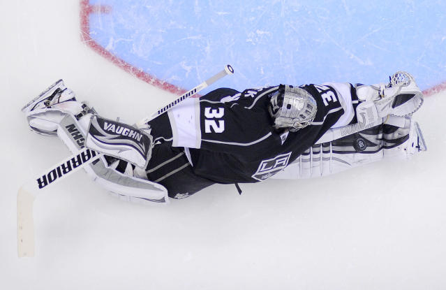 Los Angeles Kings goalie Jonathan Quick blocks a shot against the San Jose Sharks during the second period in Game 7 of the Western Conference semifinals in the NHL hockey Stanley Cup playoffs, Tuesday, May 28, 2013, in Los Angeles. (AP Photo/Mark J. Terrill)