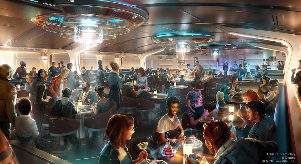 This artist concept rendering does not represent current operational guidelines or health and safety measures such as face covering and physical distancing requirements. Guests experiencing Star Wars: Galactic Starcruiser – opening in 2022 at Walt Disney World Resort in Lake Buena Vista, Fla. – will have fantastic meals in the Crown of Corellia Dining Room, seen in this artist concept rendering. The enticing supper club is a bright and welcoming hall offering menus of both otherworldly and familiar origins. One night's dinner will feature a live performance from a galactic superstar. (Disney/Lucasfilm)