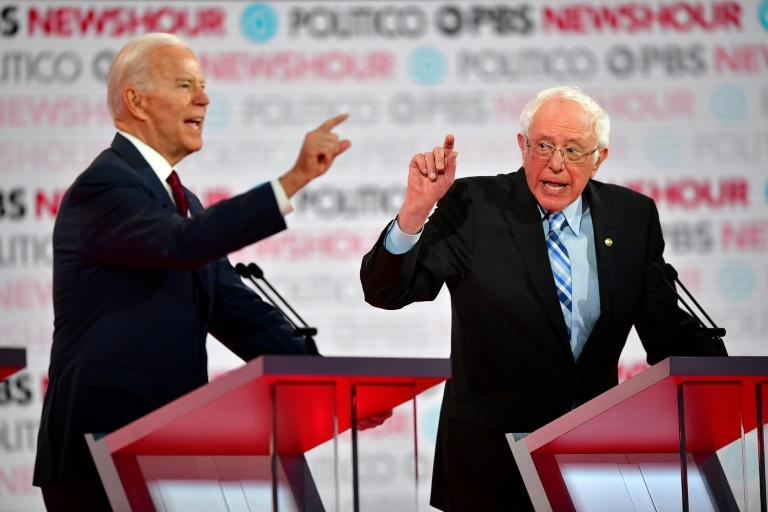 US former vice president Joe Biden (L) and liberal Senator Bernie Sanders were two of the six candidates expected to clash during the final Democratic presidential debate before Iowa begins the voting process on February 3, 2020 (AFP Photo/Frederic J. Brown)