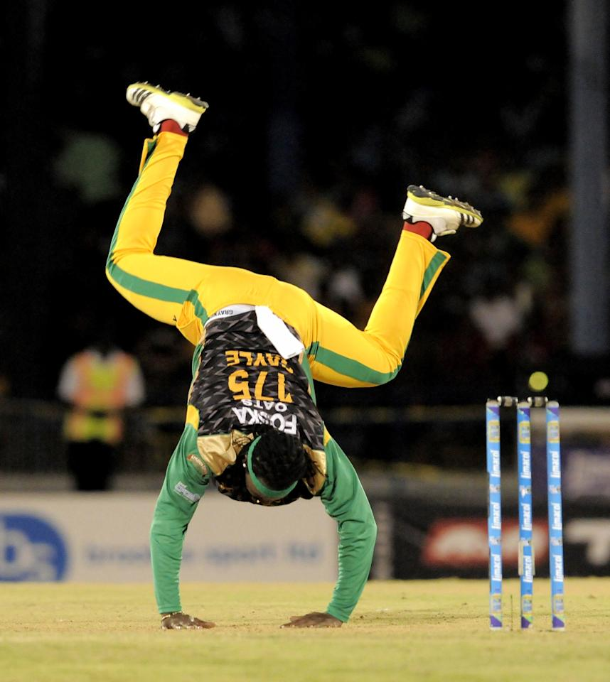 PORT OF SPAIN, TRINIDAD AND TOBAGO - AUGUST 24:  Chris Gayle of Jamaica Tallawahs failed attempt at stopping the ball during the Final of the Caribbean Premier League between Guyana Amazon Warriors v Jamaica Tallawahs at Queens Park Oval on August 24, 2013 in Port of Spain, Trinidad and Tobago. (Photo by Randy Brooks/Getty Images Latin America for CPL)