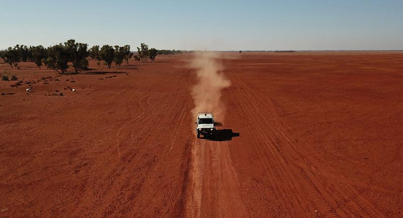 A ute drives through dust in Bollon in southwest Queensland.
