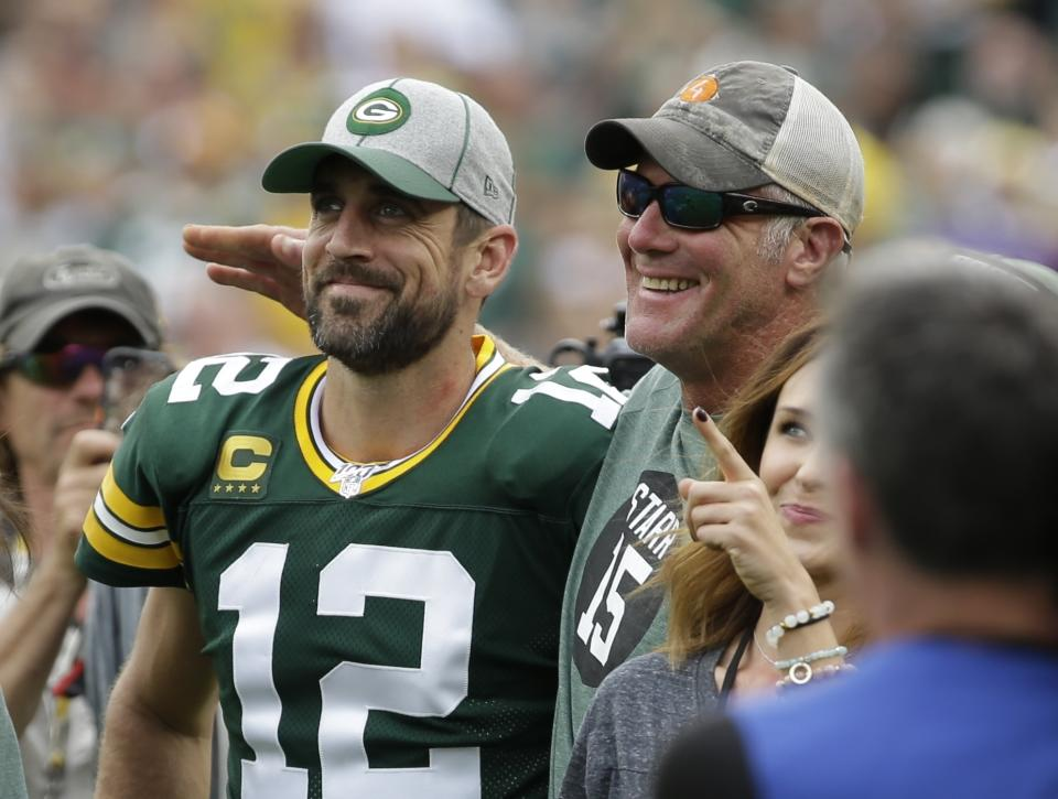 Green Bay Packers' Aaron Rodgers smiles with former quarterback Brett Favre in 2019