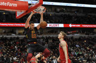 Cleveland Cavaliers' Larry Nance Jr. (22) dunks next to Chicago Bulls' Lauri Markkanen during the first half of an NBA basketball game Tuesday, March 10, 2020, in Chicago. (AP Photo/Paul Beaty)