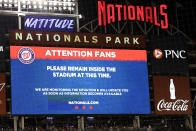 The scoreboard displays a message to fans during a stoppage in play due to an incident near the ballpark in the sixth inning of a baseball game between the Washington Nationals and the San Diego Padres, Saturday, July 17, 2021, in Washington. (AP Photo/Nick Wass)