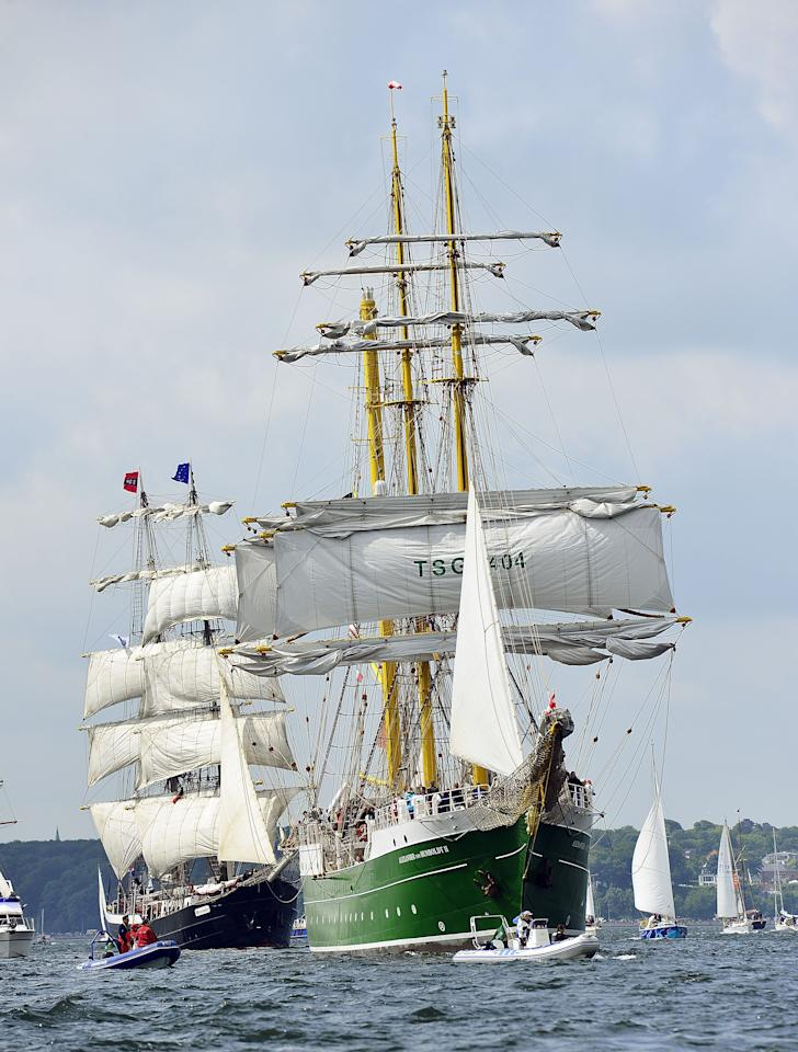 "KIEL, GERMANY - JUNE 23:  The ""Alexander von Humboldt II"" tall ship leads the Windjammer Parade of tall ships on June 23, 2012 in Kiel, Germany. The parade, which features approximately 100 tall ships and traditional large sailing ships, is the highlight of the Kieler Woche annual sailing festival, which this year is celebrating its 130th anniversary and runs from June 16-24.  (Photo by Patrick Lux /Getty Images)"