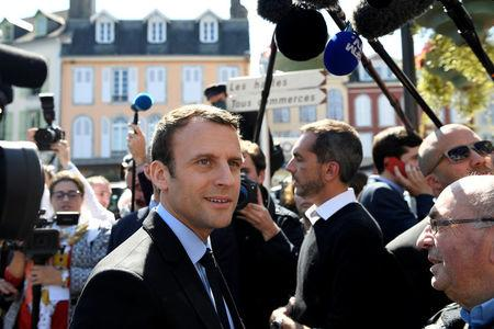 Emmanuel Macron, head of the political movement En Marche ! ( Onwards !) and candidate for the 2017 presidential election, talks with residents during a campaign visit in Bagneres de Bigorre, France, April 12, 2017.   REUTERS/Eric Feferberg/Pool