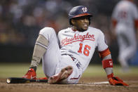 Washington Nationals' Victor Robles grimaces after being hit on the calf by a pitch from Arizona Diamondbacks' Caleb Smith during the fifth inning of a baseball game Friday, May 14, 2021, in Phoenix. (AP Photo/Darryl Webb)