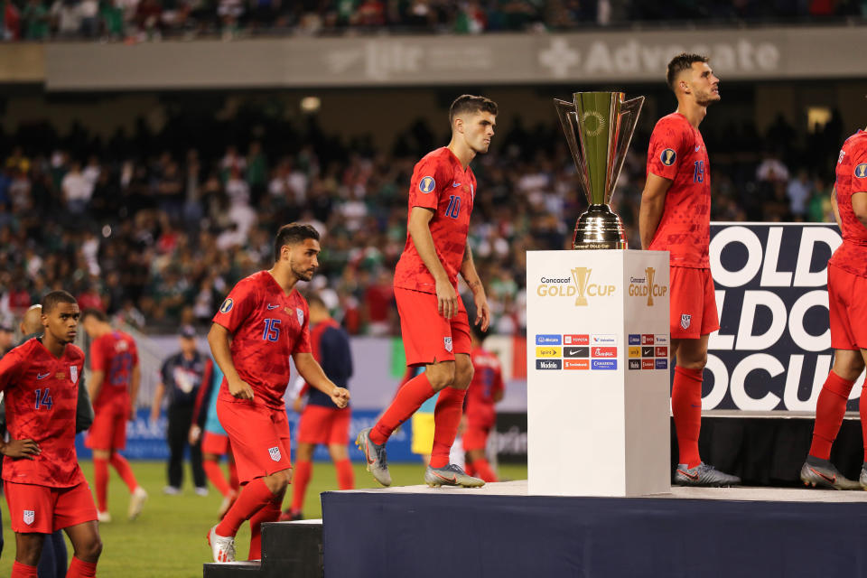 CHICAGO, IL - JULY 07: Christian Pulisic of USA walks past the CONCACAF Gold Cup trophy after USA's 0-1 defeat to Mexico in the 2019 CONCACAF Gold Cup Final between Mexico and United States of America at Soldier Field on July 7, 2019 in Chicago, Illinois. (Photo by Matthew Ashton - AMA/Getty Images)