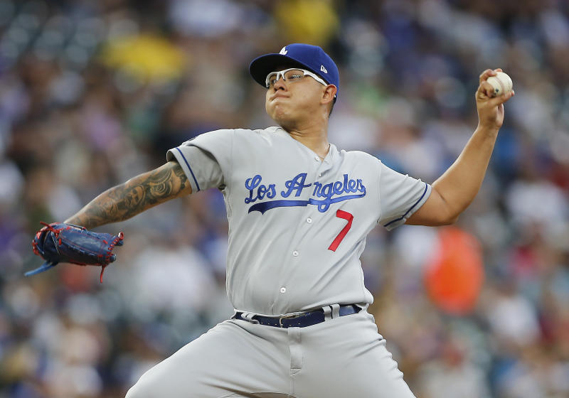DENVER, CO - JULY 30: Los Angeles Dodgers relief pitcher Julio Urias (7) delivers a pitch during a game between the Colorado Rockies and the visiting Los Angeles Dodgers on July 30, 2019 at Coors Field in Denver, CO. (Photo by Russell Lansford/Icon Sportswire via Getty Images)