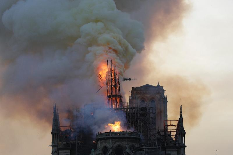 Flames and thick smoke billow from Paris' Notre Dame Cathedral