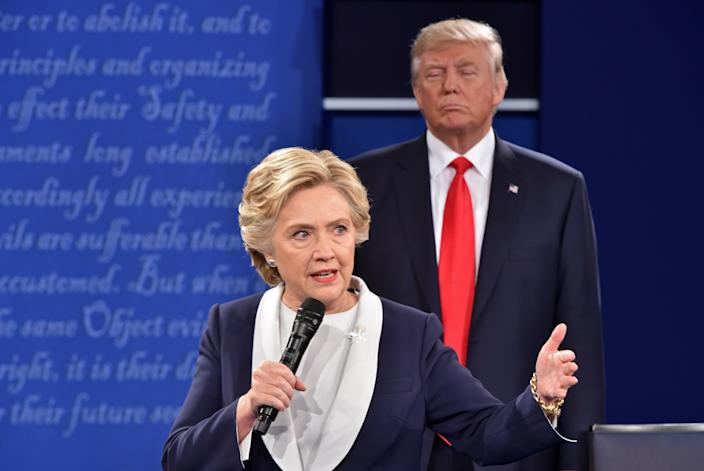 Then-Republican presidential candidate Donald Trump listens to then-Democratic presidential candidate Hillary Clinton during the second presidential debate at Washington University in St. Louis on Oct. 9, 2016.