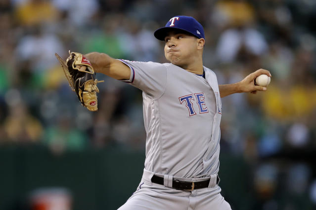 Texas Rangers pitcher Brock Burke works against the Oakland Athletics during the first inning of a baseball game Saturday, Sept. 21, 2019, in Oakland, Calif. (AP Photo/Ben Margot)
