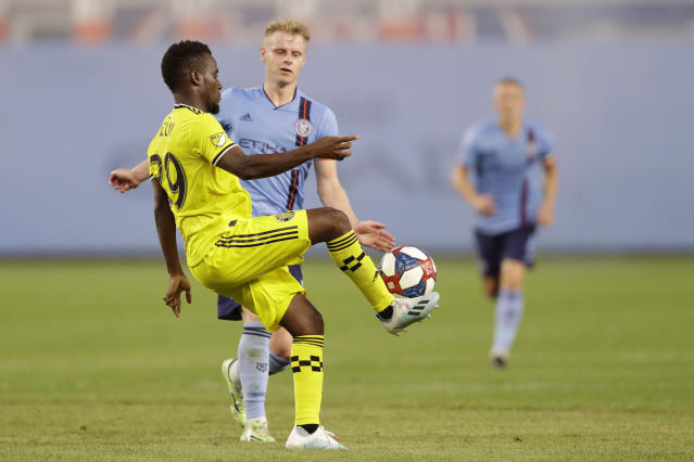 Columbus Crew forward David Accam (29), left, controls the ball in front of New York City FC midfielder Gary Macay-Steven during the first half of an MLS soccer match, Wednesday, Aug. 21, 2019, in New York. (AP Photo/Kathy Willens)