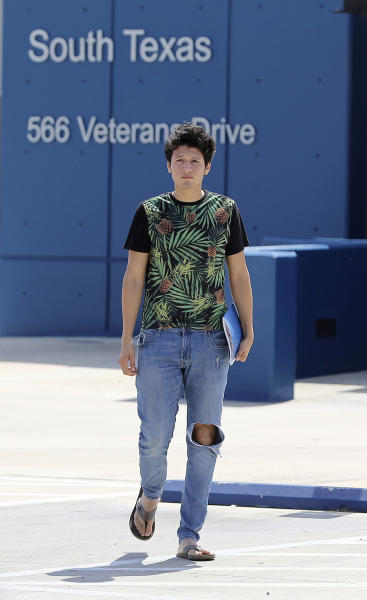 U.S. citizen Francisco Galicia, 18, walks out on his own from the South Texas Detention Facility in Pearsall, Texas, Tuesday, July 23, 2019. Galicia who was born in the U.S. has been released from immigration custody after wrongfully being detained for more than three weeks. Galicia was traveling north with a group of friends when they were stopped at a Border Patrol inland checkpoint, and he was detained for three weeks by the Border Patrol, then transferred to the ICE detention center. (Kin Man Hui/San Antonio Express-News)/The San Antonio Express-News via AP)