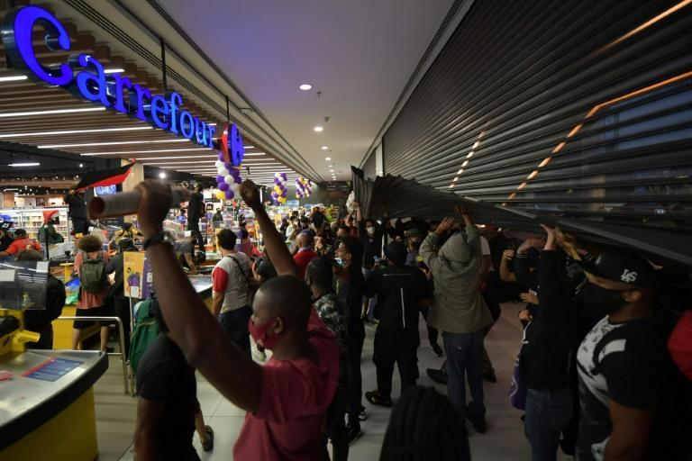 Demonstrators storm a Carrefour supermarket in Sao Paulo, Brazil, on November 20, 2020