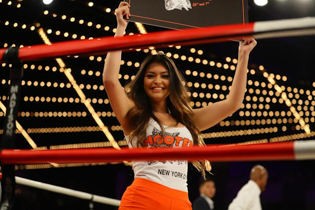 <p>A card girl from Hooters holds a ring card during the match between Brian Fielder and Brian Huang in the NYPD Boxing Championships at the Hulu Theater at Madison Square Garden on March 15, 2018. (Gordon Donovan/Yahoo News) </p>