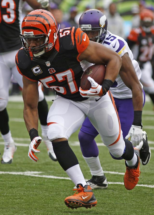 Cincinnati Bengals middle linebacker Vincent Rey (57) returns an interception against Minnesota Vikings wide receiver Greg Jennings (15) for a 25-yard touchdown in the first half of an NFL football game, Sunday, Dec. 22, 2013, in Cincinnati. (AP Photo/David Kohl)