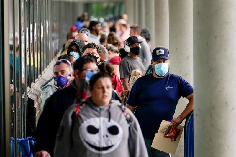FILE PHOTO: Hundreds of people line up outside a Kentucky Career Center hoping to find assistance with their unemployment claim in Frankfort