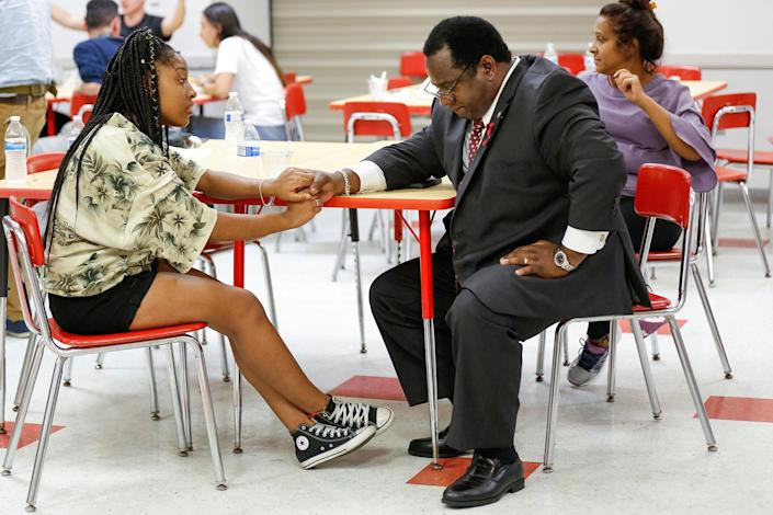 """<p>Tyra Hemans, a senior from Marjory Stoneman Douglas High School, speaks with Florida Rep. Wengay """"Newt"""" Newton, (D-St. Petersburg), during a meeting at Leon High School after the students arrived in Tallahassee, Fla., Feb. 20, 2018. (Photo: Colin Hackley/Reuters) </p>"""