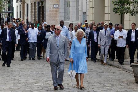 Britain's Prince Charles and Camilla, Duchess of Cornwall, walk in Old Havana, Cuba, March 25, 2019. REUTERS/Stringer