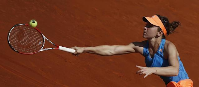 Simona Halep from Romania returns the ball during a Madrid Open tennis tournament semifinal match against Petra Kvitova from the Czech Republic in Madrid, Spain, Saturday, May 10, 2014. (AP Photo/Andres Kudacki)