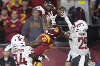 Southern California wide receiver Tyler Vaughns, center, misses a pass between Washington State safety Jalen Thompson, left, and safety Skyler Thomas during the first half of an NCAA college football game Friday, Sept. 21, 2018, in Los Angeles. (AP Photo/Jae C. Hong)