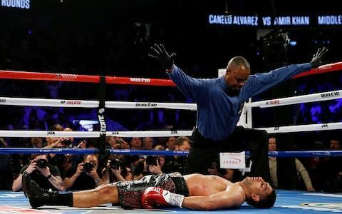 <span>Amir Khan lies flat on his back after being knocked out by Saul 'Canelo' Alvarez</span> <span>Credit: Reuters </span>