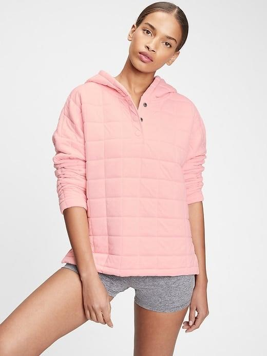 <p>Stay toasty with this <span>Gap GapFit Quilted Jacquard Hoodie</span> ($47, originally $80) solo, or as a bonus layer on those extra-cold days. </p>