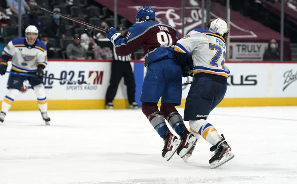 Colorado Avalanche center Nazem Kadri, left, hits St. Louis Blues defenseman Justin Faulk in the third period of Game 2 of an NHL hockey Stanley Cup first-round playoff series Wednesday, May 19, 2021, in Denver. Kadri was removed from the game for the hit. Colorado won 6-3. (AP Photo/David Zalubowski)