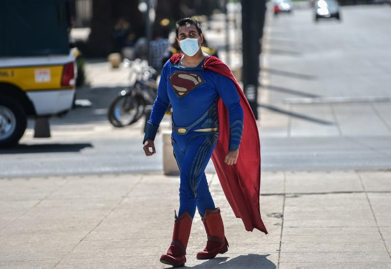 An artist disguised as Superman takes part in a protest to demand Mexican government aid, as they have been unable to work on the streets for the past month due to restrictions to prevent the spread of the novel coronavirus COVID-19 in Mexico City, on April 30, 2020. (Photo by PEDRO PARDO / AFP) (Photo by PEDRO PARDO/AFP via Getty Images)