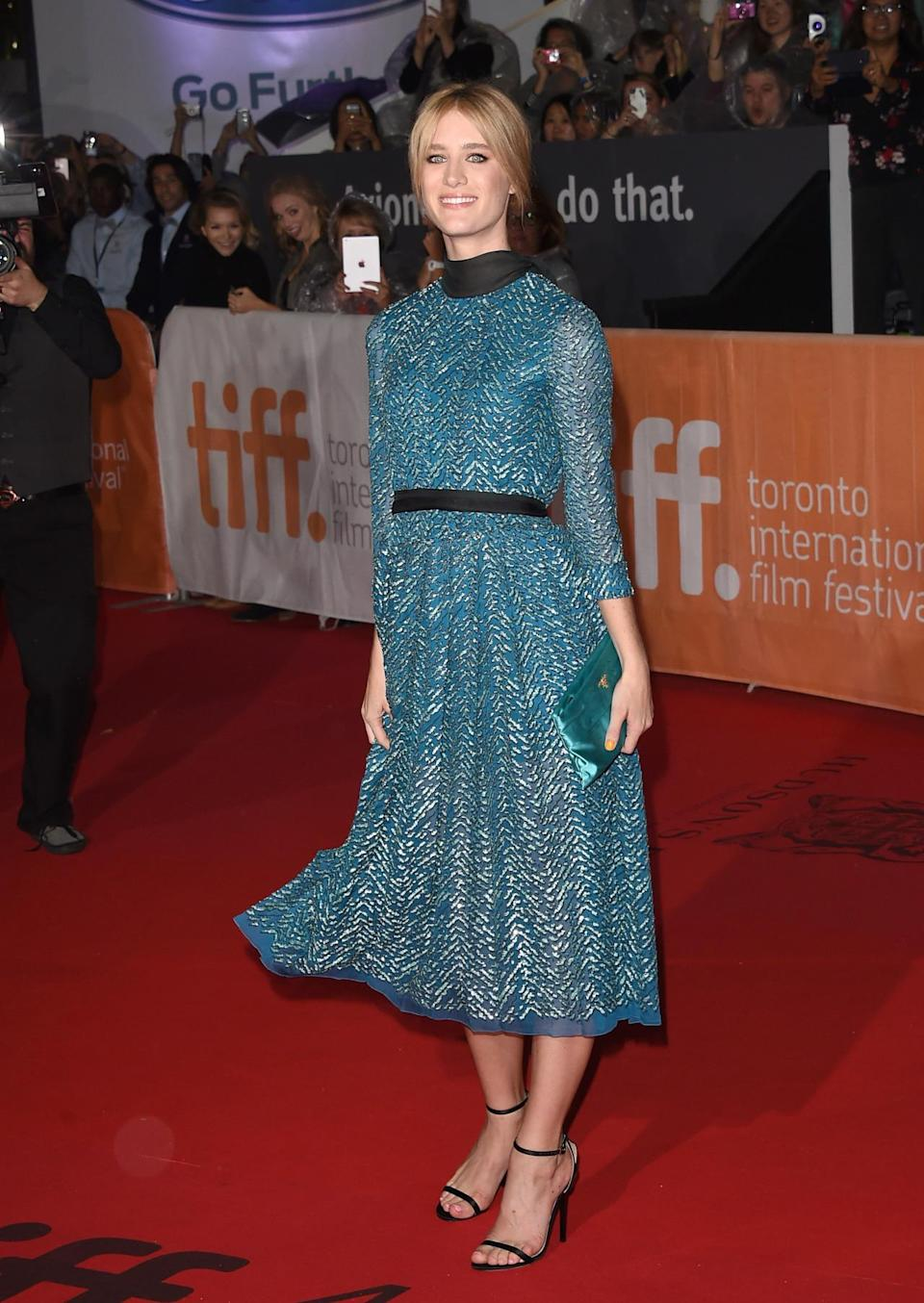 """<p>Mackenzie Davis typically plays characters with more tomboyish style, but on the red carpet at """"The Martian"""" premiere during the Toronto International Film Festival, she brought the flair and fun in a sea blue dress covered in beads arranged in a geometric pattern. </p>"""