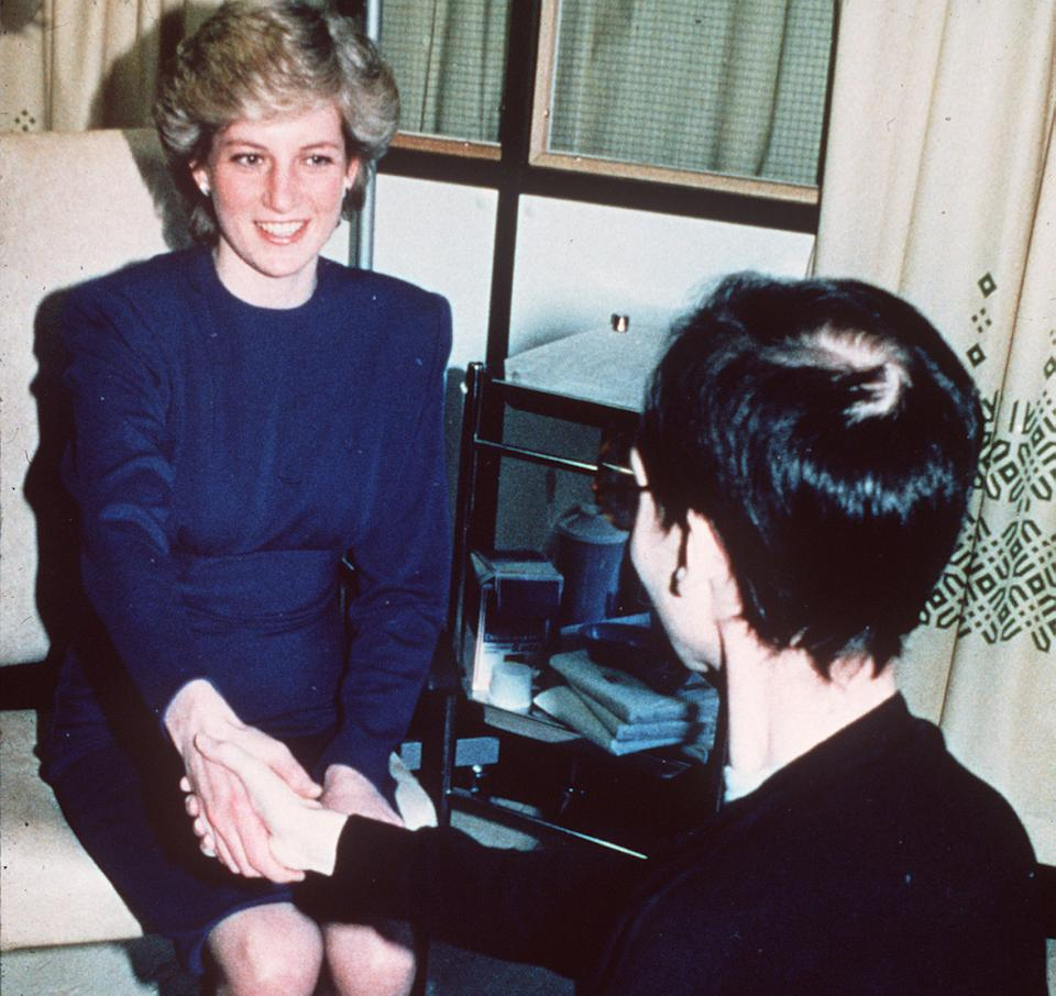 Diana, Princess of Wales shakes hands with an AIDS patient, an image that would come to symbolise her kindness and activism. (Anwar Hussein/WireImage)