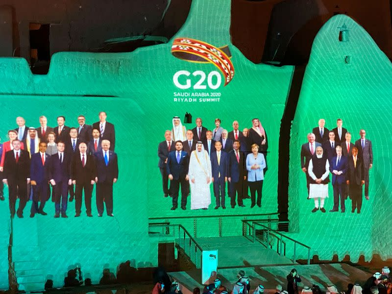 """""""Family Photo"""" for annual G20 Summit World Leaders is projected onto Salwa Palace in At-Turaif, one of Saudi Arabia's UNESCO World Heritage sites, in Diriyah"""
