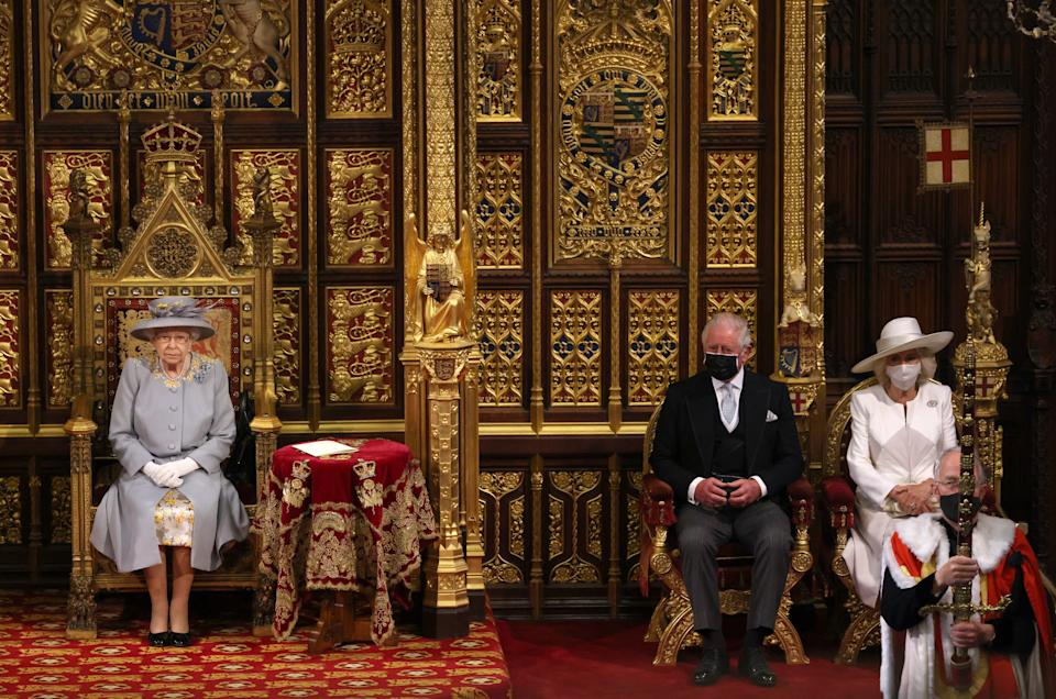 LONDON, ENGLAND - MAY 11:  Queen Elizabeth II in the House of Lord's Chamber with Prince Charles, Prince of Wales and Camilla, Duchess of Cornwall seated (R) during the State Opening of Parliament at the House of Lords on May 11, 2021 in London, England. (Photo by Chris Jackson - WPA Pool/Getty Images)