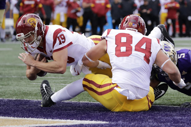 Southern Cal quarterback Matt Fink (19) scores on a three-yard carry against Washington in the first half of an NCAA college football game Saturday, Sept. 28, 2019, in Seattle. (AP Photo/Elaine Thompson)