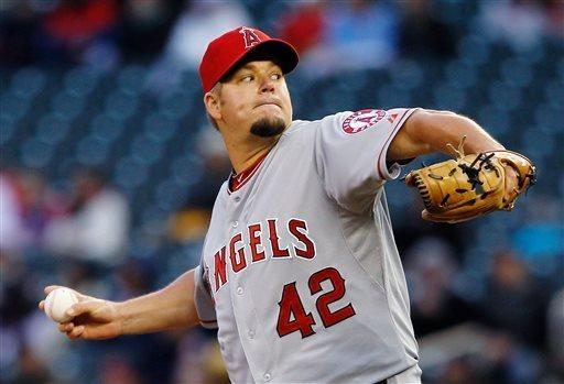 Los Angeles Angels starting pitcher Joe Blanton throws against the Minnesota Twins during the first inning of a baseball game, Monday, April 15, 2013, in Minneapolis. (AP Photo/Genevieve Ross)