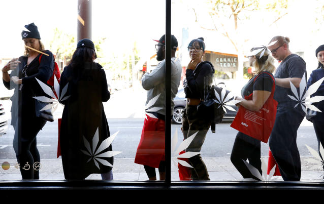 <p>Customers line up outside MedMen on the first day of recreational marijuana sales, Jan. 2, 2018 in West Hollywood, Calif. (Photo: Christina House/Los Angeles Times via Getty Images) </p>