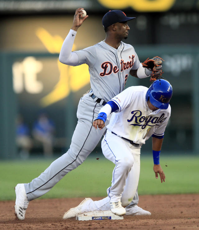 Detroit Tigers second baseman Niko Goodrum, top, forces out Kansas City Royals' Nicky Lopez (1) during the second inning of a baseball game at Kauffman Stadium in Kansas City, Mo., Friday, July 12, 2019. Goodrum had a throwing error on the play that scored Kansas City Royals' Bubba Starling. (AP Photo/Orlin Wagner)