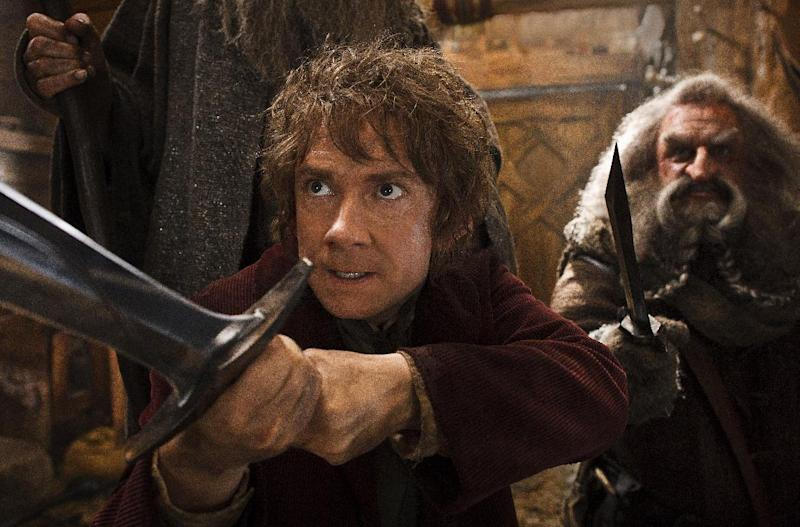 "This image released by Warner Bros. Pictures shows Martin Freeman, left, and John Callen in a scene from ""The Hobbit: The Desolation of Smaug.""The Hobbit: The Desolation of Smaug"" continued to top the box office, landing at No. 1 over the Christmas holiday for the third weekend in a row. (AP Photo/Warner Bros. Pictures, Mark Pokorny)"