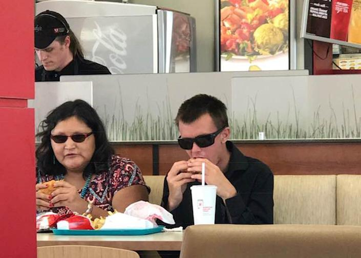 Wendy's fast food worker employee Richard Wise-Attwood has been praised for going above and beyond to help a blind couple enjoy their meal. Source: Cindy Griswold / Facebook