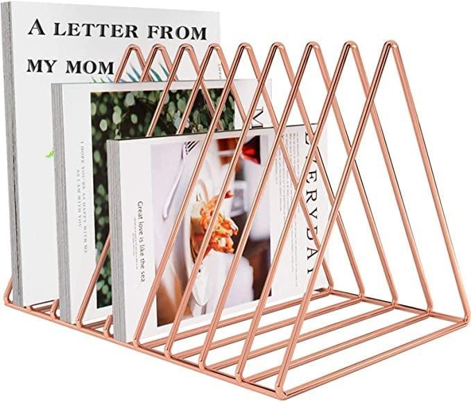 <p>Keep files, folders, tablets, and more tucked away with this <span>Triangle Stand Desktop File Organizer</span> ($17). It comes in gold and rose gold.</p>