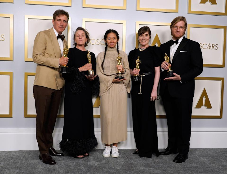 """Producers Peter Spears, from left, Frances McDormand, Chloe Zhao, Mollye Asher and Dan Janvey, winners of the award for best picture for """"Nomadland."""""""