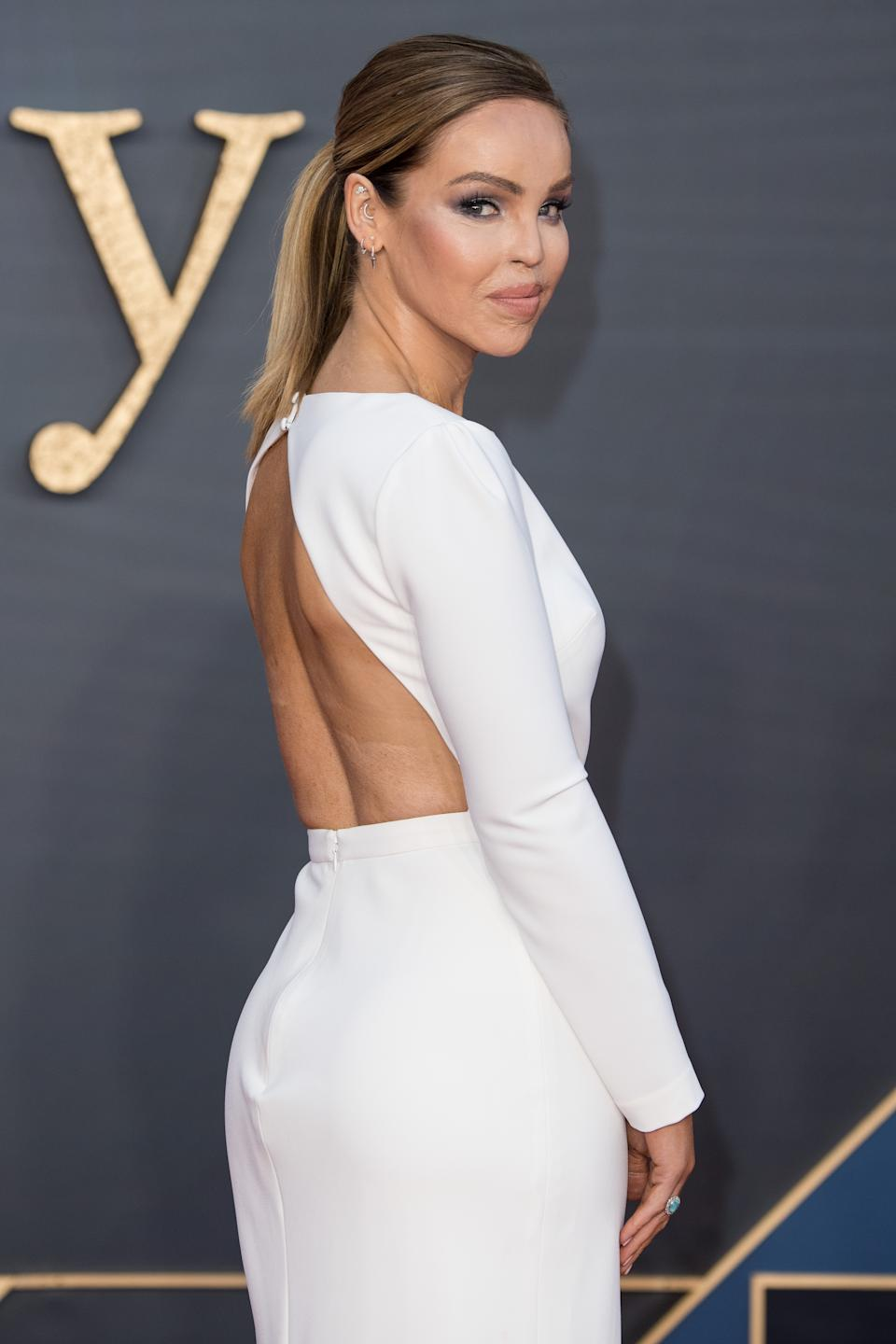 Katie Piper attended the London Premiere wearing a chic, white backless dress by Ted Baker [Photo: Getty Images]