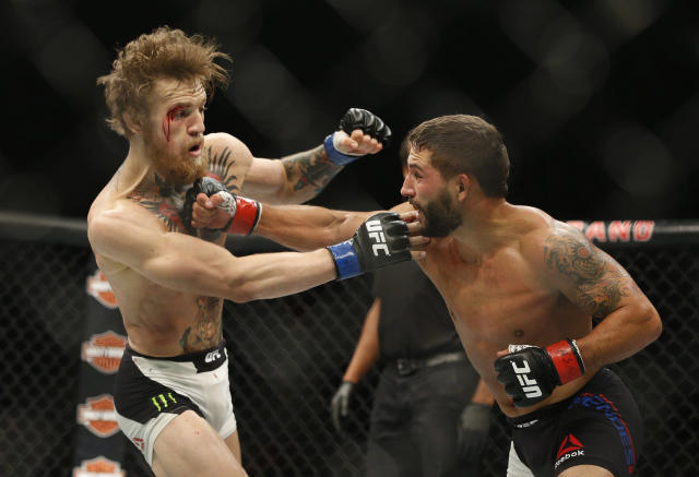 <p>McGregor became the interim champion in this bout when he got off the mat to stop Mendes with strikes late in the second round. Mendes was a burly wrestler, just the type of opponents that McGregor's critics said he couldn't deal with. Mendes pinned McGregor and seemed to be on the verge of finishing him, but McGregor worked his way to his feet and used his hands and kicks to the body to turn the fight in his favor. </p>