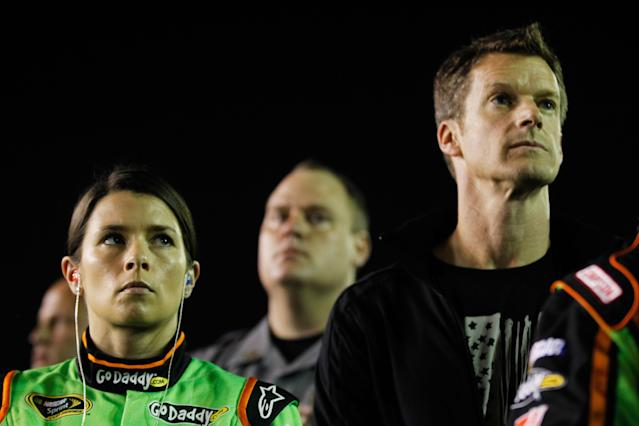 DAYTONA BEACH, FL - FEBRUARY 27: Danica Patrick, driver of the #10 GoDaddy.com Chevrolet, stands with husband Paul Hospenthal on the grid prior to the start of the NASCAR Sprint Cup Series Daytona 500 at Daytona International Speedway on February 27, 2012 in Daytona Beach, Florida. (Photo by Streeter Lecka/Getty Images)