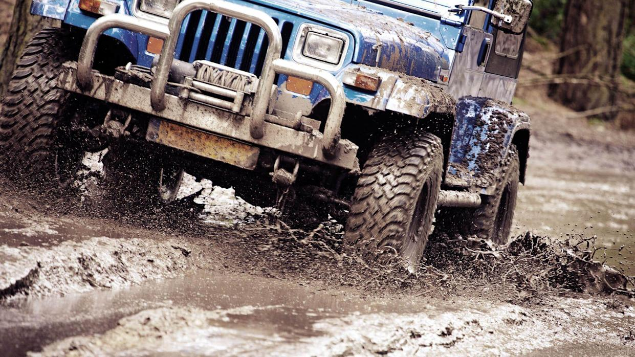 off-road vehicle riding in dirt.