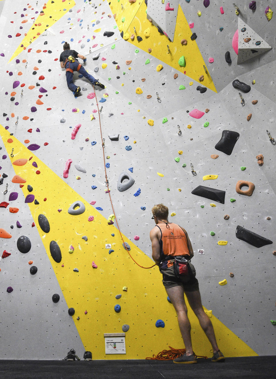 Climbers at The Castle Climbing Centre in London, as lockdown restrictions are eased to allow indoor gyms to restart activities Saturday July 25, 2020. Indoor gyms, swimming pools and sports facilities can reopen as part of the latest easing of coronavirus lockdown measures in England Saturday. (Kirsty O'Connor/PA via AP)