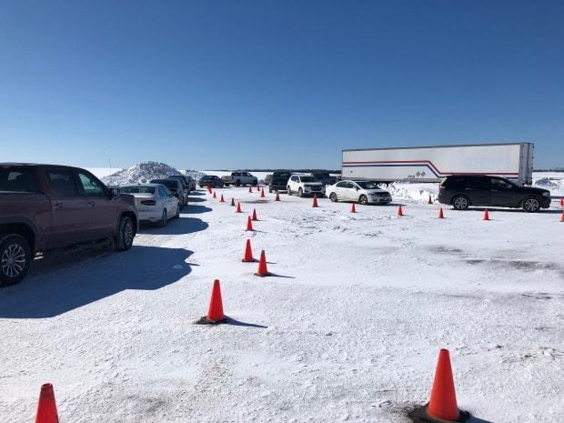 Drivers seeking COVID-19 tests in faced a long wait in line at the Slemon Park testing centre near Summerside Friday. (Brittany Spencer/CBC - image credit)